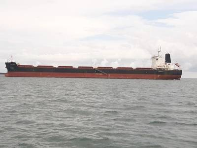 A large bulker awats cargo at an African port (Credit: Joe Keefe)