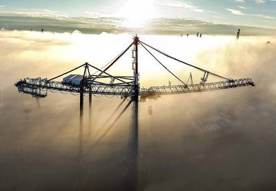Liebherr STS crane rising above the fog. Photo courtesy Liebherr.