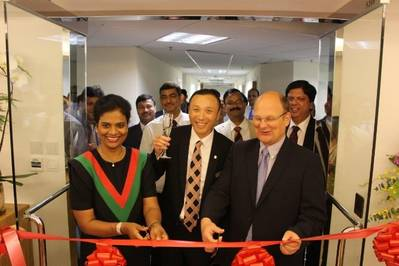 LUKOIL Marine's Managing Directors June Manoharan and Jan Thiedeitz at the opening ceremony ribbon cutting. (Photo: LUKOIL Marine)