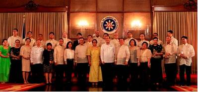 Back row:  Magsaysay-MOL President Francisco D. Menor is third from the left.     Front row:  Philippine Overseas Employment Administration (POEA) Administrator Hans Leo J. Cacdac is eighth from the left;  Secretary of the Department of Labor and Employment (DOLE), Rosalinda Dimapilis-Baldoz is ninth from the left; and  Philippine President Benigno Simeon Aquino III is tenth from the left.