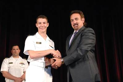 Northrop Grumman Corporation presented the 2014 Elmer A. Sperry Junior Navigator of the Year Award to Midshipman Robert Francisco Yerkes-Medina in ceremonies at the U.S. Naval Academy. The award was presented by Jeff Holloway (right), director of the company's Charlottesville, Virginia, campus and an academy graduate. (Photo courtesy of Northrop Grumman)