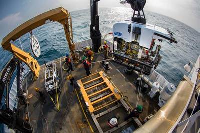 Okeanos Explorer's dual-body ROV system is loaded from the aftdeck of the ship into the water before conducting an exploration dive. (Credit: NOAA)