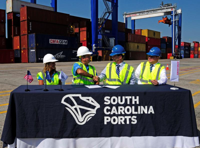 From left, SC Ports Authority Senior Vice President of Operations and Terminals Barbara Melvin and CEO Jim Newsome celebrate the purchase of 26 rubber-tired gantry cranes with Konecranes representatives Mika Mahlberg, Executive Vice President of Port Solutions and Jussi Suhonen, Regional Sales Director Americas, Port Solutions. (Photo: SCPA)