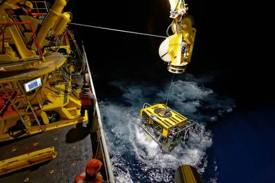 The ROPOS ROV surfaces as it comes up from a night dive.