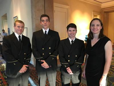 From left: Scholarship recipients Samuel Comerford, Alex Yonkman and Tyler Sayvetz with Crowley's Victoria Ellis. Not shown: Kent Treptow (Photo: Crowley)