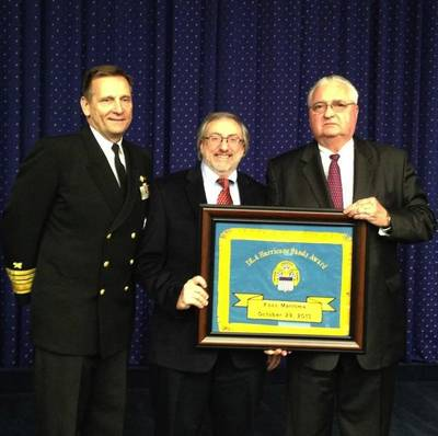 John Tirpak, far right, accepting the hand-embroidered flag award for Foss. The flag is made by a Philadelphia based woman-owned business in the spirit of Betsy Ross.