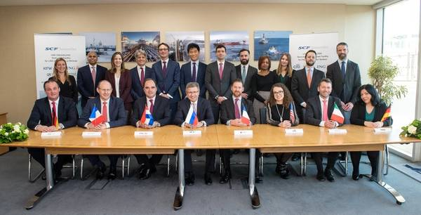Nikolay Kolesnikov, Senior Executive Vice-President and CFO of Sovcomflot (sitting in the centre) together with the signees from KfW IPEX-Bank, Credit Agricole, ING Bank, Societe Generale, Citibank, UniCredit, and DVB Bank (sitting, from left to right). Photo: Sovcomflot