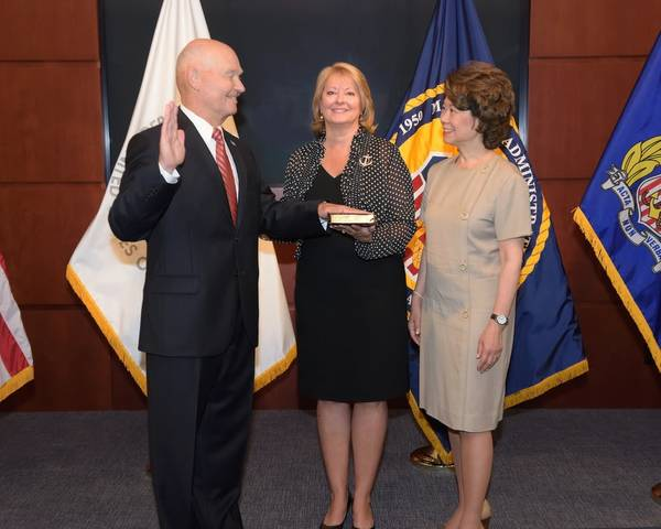 U.S Secretary of Transportation Secretary Elaine L. Chao administers the Oath of Office to Rear Adm. Mark H. Buzby, USN, Ret. as Maritime Administrator (L to R: Admiral Mark H. Buzby,  Gina Buzby and Secretary Elaine L. Chao) (Photo: MARAD)