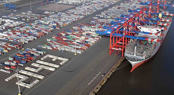 """To welcome the world's largest containership OOCL Germany in Wilhelmshaven, EUROGATE employees use containers to write the ships TEU capacity """"21413"""" near the vessel's berthing area (Photo: EUROGATE)"""