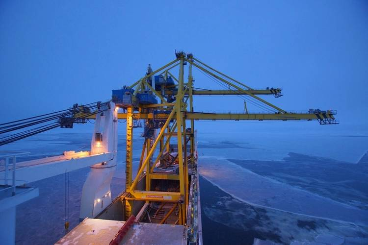 HHL Valparaiso is the first vessel to sail open hatch through the Northern Sea Route, as it delivers two giant ship-to-shore (STS) cranes across Russia. (Photo: HHL)