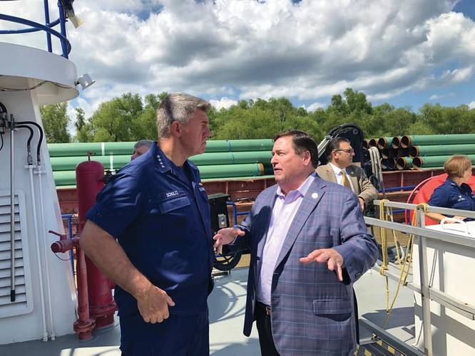 Admiral Karl Schultz, Commandant, USCG discussing the situation on the Lower Mississippi River with Lt. Governor Billy Nungesser – State of Louisiana. Photo: Greg Trauthwein