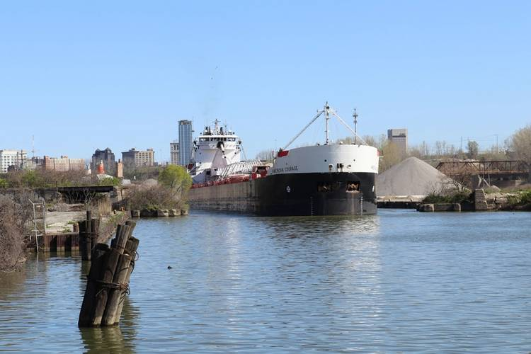 American Steamship Company's M/V American Courage upbound on the Cuyahoga River in Cleveland, Ohio with a load of taconite from the iron ranges on Lake Superior for ArcelorMittal Cleveland, one of the most productive integrated steel mills in the world. (Photo Credit: Thomas Rayburn)