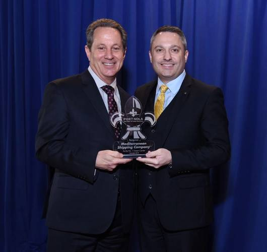 Bobby Landry, Port NOLA VP of Commercial, presents an award to Fabio Santucci, MSC, at the 2018 Cargo Connections Conference. (Photo: Port NOLA)