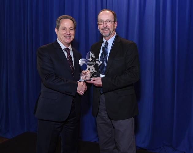 Bobby Landry, Port NOLA VP of Commercial, presents an award to Rick Gros, Shintech, at the 2018 Cargo Connections Conference. (Photo: Port NOLA)