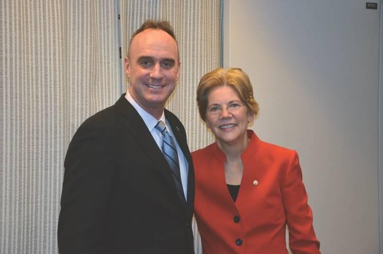 Doyle with Elizabeth Warren (Photo: FMC)
