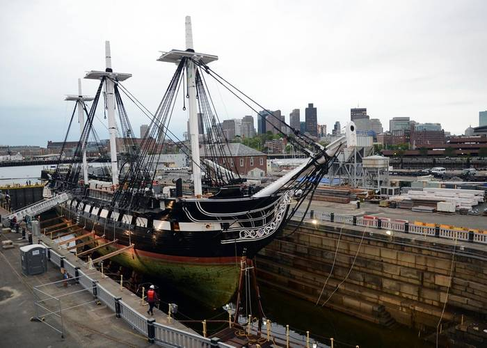 The entire hull of USS Constitution is exposed for the first time in 19 years as Dry Dock 1 in Charlestown Navy Yard is dewatered. Constitution entered the dock last night to commence a multi-year planned restoration period.