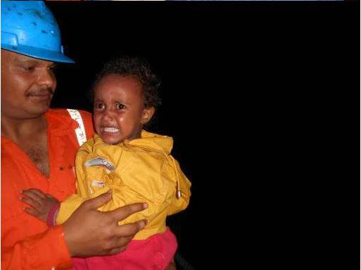 "Crew members of the Synergy Managed bulker ""Jupiter Bay"" help two infants to safety who were among 322 people rescued from small overcrowded boats early on Saturday morning. Part of the humanitarian operation that the Italian Navy reports has seen the rescue of some 5200 people trying to cross from North African to Europe since Thursday June 5th. All 322 individuals were disembarked safely at the Italian Port of Pozzallo, Sicily on Saturday evening (7th)."