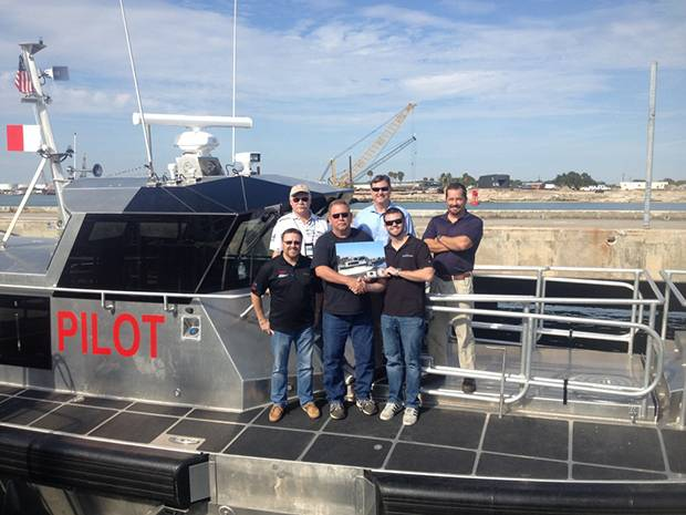 Metal Shark's director of sales Dean Jones presents the Canaveral Pilots Association with a plaque commemorating the delivery of the Association's new pilot boat. On hand to mark the occasion for the Pilots are business director Doug Mutter, director of engineering Mike Rigby, co-chairmen Ben Borgie and Doug Brown, and boat committee member Richard Grimson. (Photo: Metal Shark)