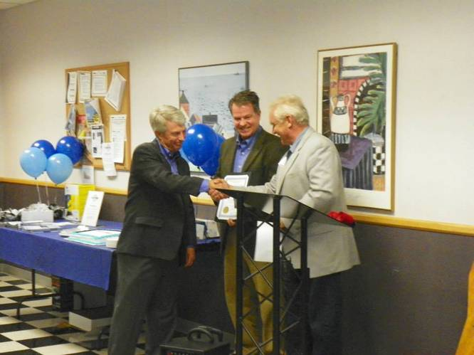 St. Michael, Minnesota Mayor Jerry Zachman presents Jet Edge President Jude Lague and TC/American Monorail President Paul Lague with a resolution from the St. Michael City Council. Photo courtesy I-94 West Chamber of Commerce.