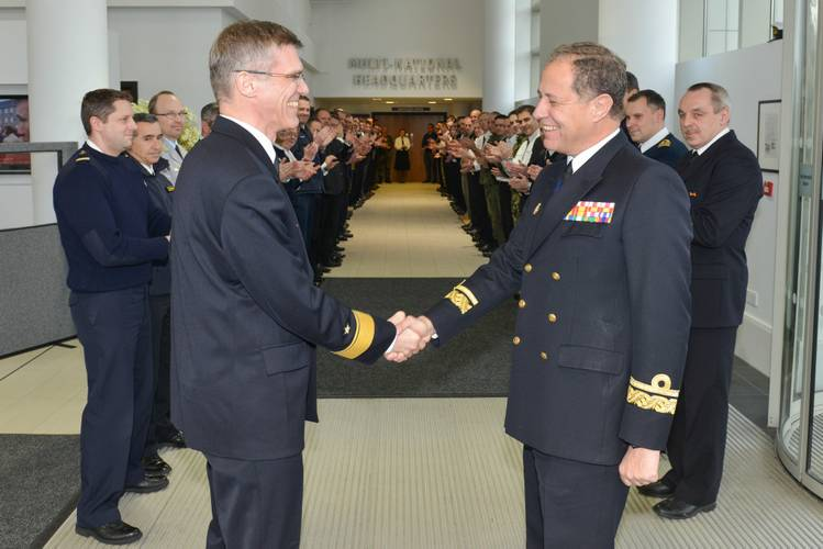 Outgoing DCOM Rear Admiral Martens shakes hands with incoming DCOM Rear Admiral Bauzá as the Operational HQ staff applaud (Photo courtesy EU NAVFOR)
