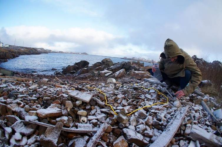 A researcher gathers marine plastic pollution from a rocky shoreline in Fogo Island, Newfoundland. The MEOPAR network and Irving Shipbuilding announced $1.8 million in funding to support nine ocean research initiatives, including four projects examining various environmental and industry challenges facing the oceans on Canada's East Coast. (Photo: Irving Shipbuilding)