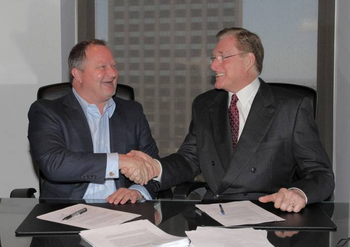 Shane J. Guidry, Chairman & CEO, Harvey Gulf (left) and J. Barry Snyder, President, Signet Maritime sign closing documents on May 15 at Harvey Gulf International Marine in New Orleans, Louisiana for the sale of Harvey's Offshore Towing Division to Signet Maritime.