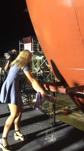 The ship's sponsor Emma Engle christens the vessel (Photo: General Dynamics NASSCO)