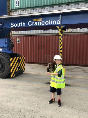 "Jack Sibley-Jones, a fifth grader at Blythe Academy, visits Inland Port Greer to see the rubber-tired gantry crane he named ""South Craneolina"" as part of the Port's crane-naming contest."