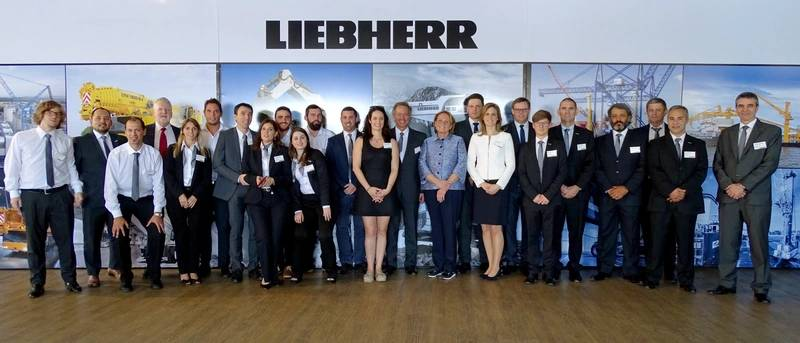 Staff from Liebherr Argentina celebrating the opening of the Buenos Aires subsidiary with members of the Liebherr family (Photo: Liebherr)