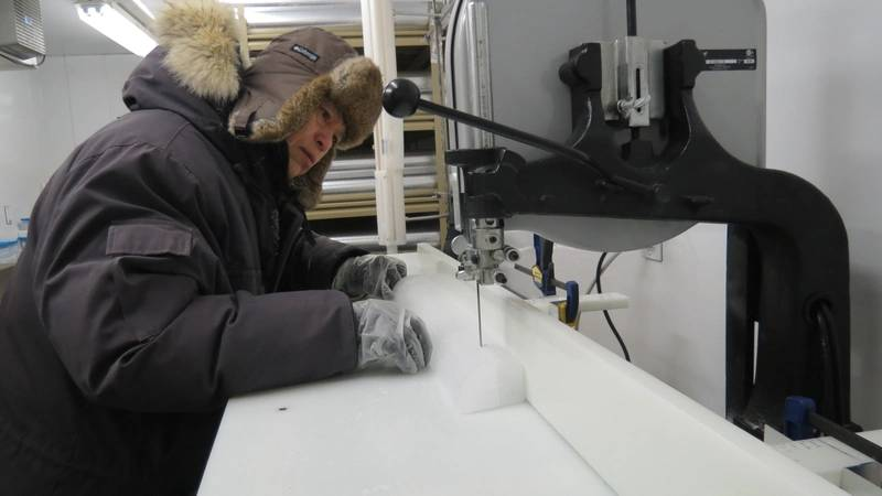 Using a special band saw, SDSU chemistry professor Jihong Cole-Dai slices off a piece of ice core from Western Antarctica. The specimens are stored at -4 degrees Fahrenheit in the university's Ice Core and Environmental Che