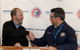 Anthony Chiarello, president and CEO of TOTE, and Kevin Graney, vice president and general manager at General Dynamics NASSCO, shake hands following delivery signing ceremony aboard the Perla Del Caribe at the NASSCO shipyard. (Photo: General Dynamics NASSCO)